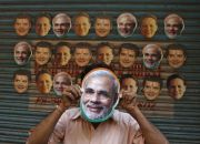 a-vendor-wears-a-mask-of-narendra-modi-prime-minister-of-india