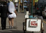 a-picture-of-a-married-couple-walking-the-streets-of-mexico